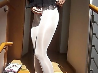 Sexy toying pussy with sexy long legs putting on layers of pantyhose