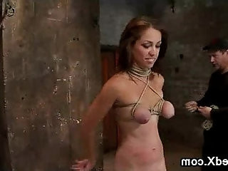 Tied up babe with tits on her knees gives blowjob