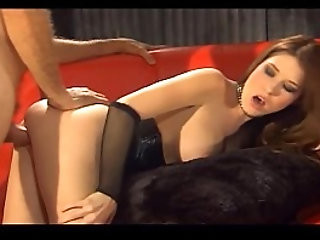Sex in black fishnet lingerie and a shiny corset