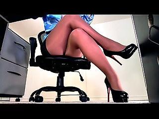 Sexy sheer pantyhose legs and high heel dangle