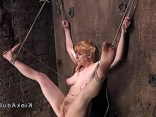 Busty tied up redhead gagged and toyed