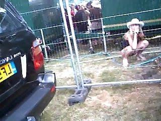 festival piss voyeur with smartphone
