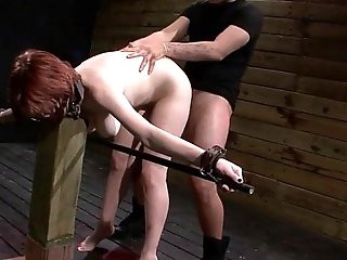 Bound redhead Velma DeArmond deep in her throat fucked