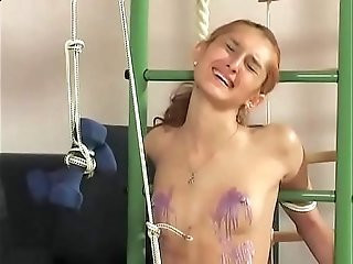 Slim and beautiful girl gets a harsh bdsm treatment.